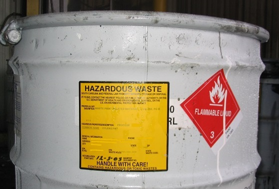 (labeled chemical waste drum)